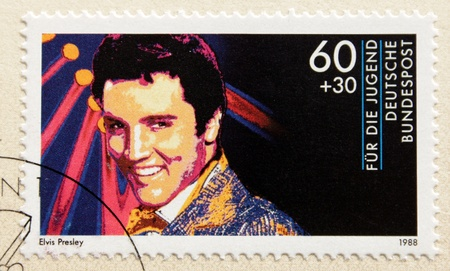 GERMANY - CIRCA 1988. A postage stamp printed in Germany shows image portrait of famous American singer Elvis Presley (1935-1977), circa 1988. Stock Photo - 10230240