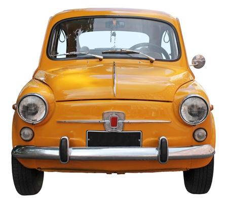 auto old: Viejo coche pequeño y aislado en el fondo blanco. Vista frontal. Editorial