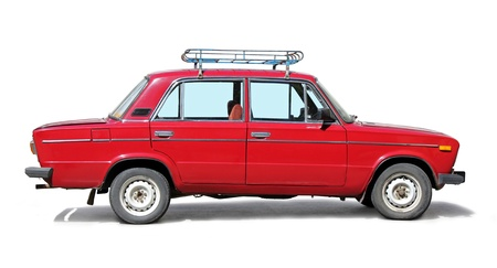 russian car: Old red car side view on white background.