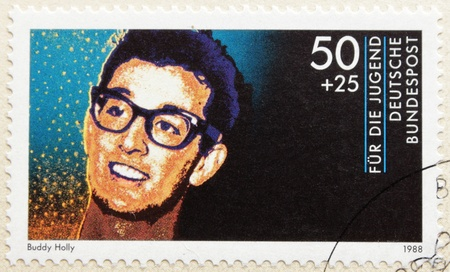 GERMANY - CIRCA 1988. A postage stamp printed in Germany shows image portrait of famous American singer- songwriter and pioneer of rock and roll Buddy Holly (Charles Hardin Holley) (1936-1959), circa 1988. Stock Photo - 10815589