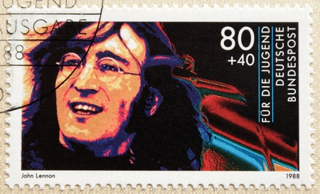 english famous: GERMANY - CIRCA 1988. A postage stamp printed in Germany shows image portrait of famous English musician singer and songwriter John Winston Lennon (1940-1980), circa 1988.