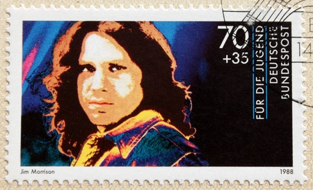 jim: GERMANY - CIRCA 1988. A postage stamp printed in Germany shows image portrait of famous American singer and poet Jim Morrison (James Douglas Morrison) (1943-1971).