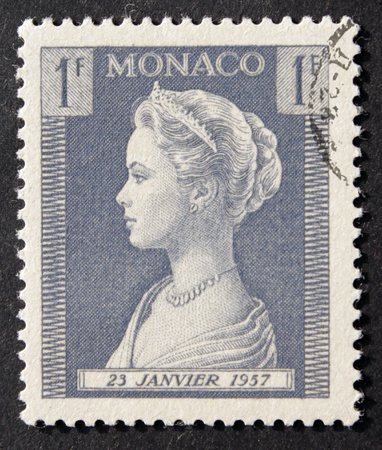MONACO - CIRCA 1957. Vintage stamp printed in Monaco shows image portrait of famous American actress Grace Kelly (1929-1982) who married Rainier III Prince of Monaco.