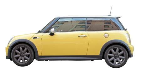 mini car: Small stylish yellow car side view isolated on white background Editorial