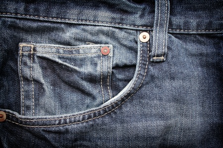Close-up of blue jeans pocket. Suitable for an abstract background. photo