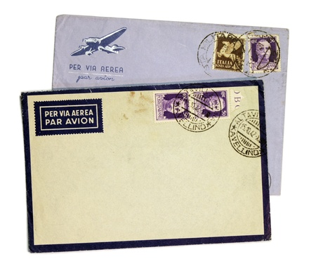 Two vintage airmail envelopes with King Victor Emmanuel III postage stamps from Italy.  Stock Photo