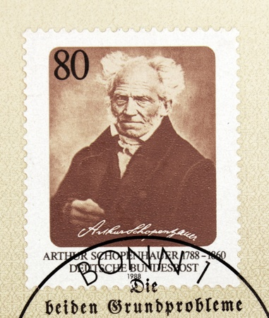 pessimism: Germany - CIRCA 1988. A postage stamp printed in Germany shows image portrait of German  philosopher Arthur Schopenhauer (1788-1860) known for his pessimism and philosophical clarity.