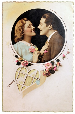 France - CIRCA 1913. Vintage postcard with hand-tinted photograph of man and woman in romantic pose. Circa 1913. Editorial