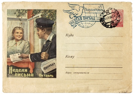 RUSSIA - CIRCA 1959: old envelope printed in Soviet Union shows Russian postman and young woman. Text in the image means:  photo