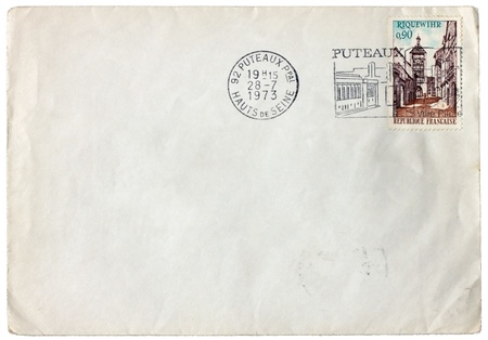FRANCE - CIRCA 1973: a stamp printed by FRANCE shows view of Riquewihr town. Vintage postmark from French town Puteaux on an old  envelope, circa 1973.  photo