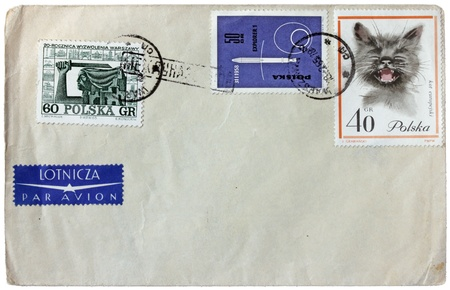 POLAND - CIRCA 1965: A set of three stamps printed by POLAND shows satellite Explorer 1, Siren monument in Warsaw and funny cat, circa 1965  photo