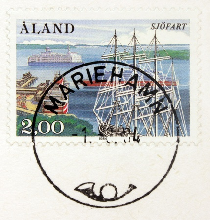 ALAND ISLANDS - CIRCA 1944: A  stamp printed by ALAND ISLANDS shows view of Mariehamn harbor, circa 1984  photo