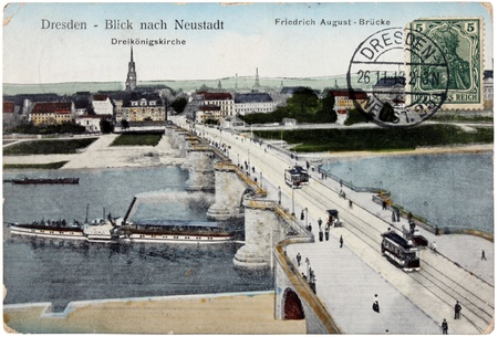 GERMANY - CIRCA 1913: A stamps printed by GERMANY shows women in ancient armor. Stamp is on the old  postcard shows view of  Friedrich August Bridge in Dresden, circa 1913. Stock Photo - 12834301