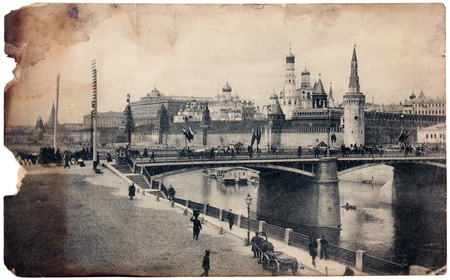 RUSSIA - 1910: Vintage postcard printed by RUSSIA shows view of the Kremlin in Moscow. Postcard is partially burned on the edges, circa 1910. photo