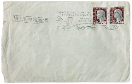 postmark: FRANCE - CIRCA 1963: a set of two stamps printed by FRANCE shows woman portrait - personification of France. Postmark from French town Anse and Russian postmark  Stock Photo