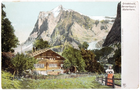 canton: SWITZERLAND - CIRCA 1903: a postcard printed in SWITZERLAND shows view of Wetterhorn mountain above Grindelwald village in Canton of Bern, circa 1903.