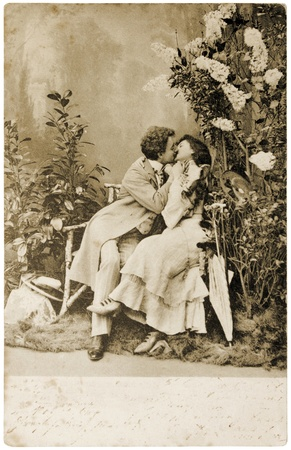 circa: GERMANY - CIRCA 1904: a postcard printed in Germany shows sepia toned photograph of couple in love, circa 1904. Editorial