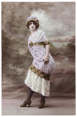 FRANCE - CIRCA 1906: a vintage postcard printed in France shows hand painted photograph of beautiful lady in fashion dress of 1906. Circa 1906. Editorial
