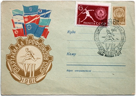 RUSSIA - CIRCA 1961: a stamp printed by Soviet Union shows javelin throwing. Text in the postmark and envelope means:  photo