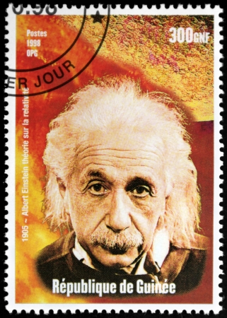 physicist: GUINEA - CIRCA 1998. A postage stamp printed by GUINEA shows image portrait of famous American physicist Albert Einstein (1879-1955), circa 1998. Editorial