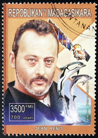 MADAGASCAR - CIRCA 1999. A postage stamp printed by Madagascar shows image portrait of famous French and Spanish actor Jean Reno, circa 1999.