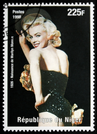 NIGER - CIRCA 1998: A postage stamp printed by Niger shows image portrait of famous American actress, model and singer Marilyn Monroe (1926-1962), circa 1998