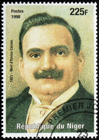 NIGER - CIRCA 1998: A postage stamp printed by Niger shows image portrait of famous Italian singer Enrico Caruso (1873-1921), circa 1998. Stock Photo - 14564581