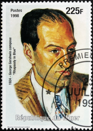NIGER - CIRCA 1998: A postage stamp printed by Niger shows image portrait of famous American composer and pianist George Gershwin (1898-1937), circa 1998. Stock Photo - 14857661
