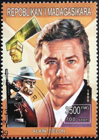 MADAGASCAR - CIRCA 1999. A postage stamp printed by Madagascar shows image portrait of famous French actor Alain Delon, circa 1999.