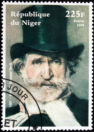 composer: NIGER - CIRCA 1998: A postage stamp printed by Niger shows image portrait of famous romantic Italian composer Giuseppe Verdi (1813-1901), circa 1998. Editorial