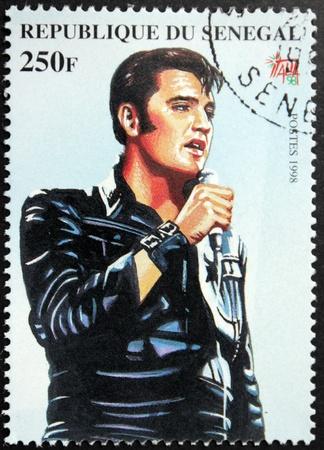 elvis: SENEGAL - CIRCA 1998. A postage stamp printed by Senegal shows image portrait of famous American singer Elvis Presley (1935-1977), circa 1998.
