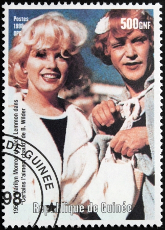 GUINEA - CIRCA 1998: A postage stamp printed by Guinea shows famous American actress Marilyn Monroe and actor Jack Lemmon starring in the film  Stock Photo - 14857669