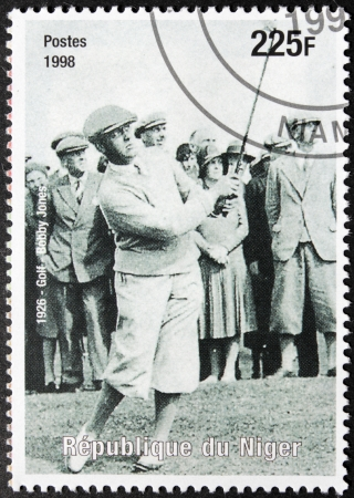 jones: NIGER - CIRCA 1998: A postage stamp printed by Niger shows image portrait of famous American amateur golfer Robert Tyre  Editorial