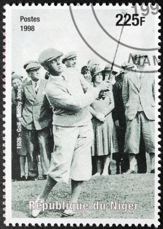 amateur: NIGER - CIRCA 1998: Un sello impreso por N�ger muestra imagen Retrato del famoso golfista amateur estadounidense Robert Tyre
