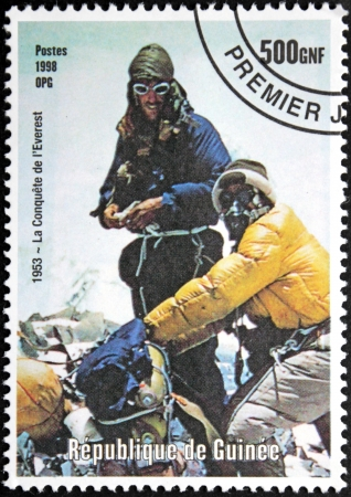 GUINEA - CIRCA 1998. A postage stamp printed by GUINEA shows Mont Everest first successful ascent by Edmund Hillary and Tenzing Norgay (1953), circa 1998. Stock Photo - 14963201