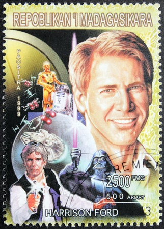 jones: MADAGASCAR - CIRCA 1999. A postage stamp printed by Madagascar shows image portrait of famous American actor and film producer Harrison Ford, circa 1999.