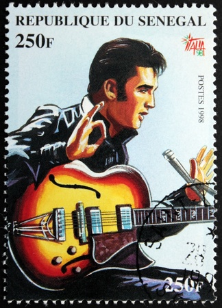 elvis presley: SENEGAL - CIRCA 1998. A postage stamp printed by Senegal shows image portrait of famous American singer Elvis Presley (1935-1977), circa 1998.