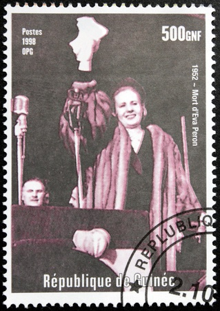 peron: GUINEA - CIRCA 1998. A postage stamp printed by GUINEA shows image portrait of  Spiritual Leader of the Nation of Argentina Eva Peron, circa 1998. Editorial
