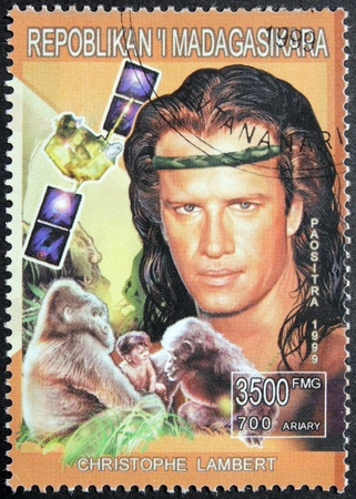MADAGASCAR - CIRCA 1999. A postage stamp printed by Madagascar shows image portrait of an American-born French actor Christophe Guy Denis