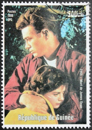 dean: GUINEA - CIRCA 1998. A postage stamp printed by Guinea shows image portrait of famous American actor James Dean, circa 1998. Editorial