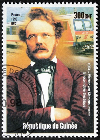 GUINEA - CIRCA 1998  A postage stamp printed by GUINEA shows image portrait of  German inventor and industrialist Werner von Siemens, the founder of company Siemens, circa 1998  Stock Photo - 15318619
