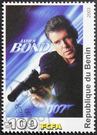 BENIN - CIRCA 2003: A postage stamp printed by Benin shows Irish actor Pierce Brosnan starring in the film