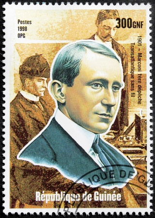 GUINEA - CIRCA 1998. A postage stamp printed by GUINEA shows image portrait of famous Italian physicist and inventor Guglielmo Marconi, circa 1998. Stock Photo - 15485097