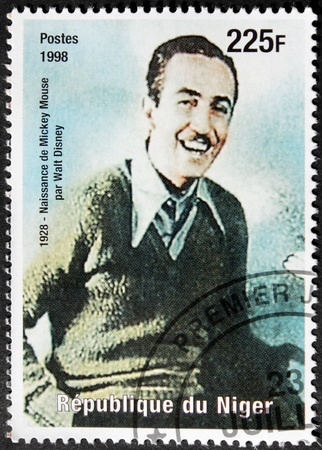 NIGER - CIRCA 1998: A postage stamp printed by Niger shows image portrait of famous American film producer, director, screenwriter aand animator Walt Disney, circa 1998 Stock Photo - 15485091