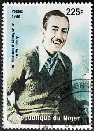 screenwriter: NIGER - CIRCA 1998: Un francobollo stampato dal Niger mostra ritratto immagine del famoso produttore cinematografico, regista, sceneggiatore aand animatore Walt Disney, circa 1998