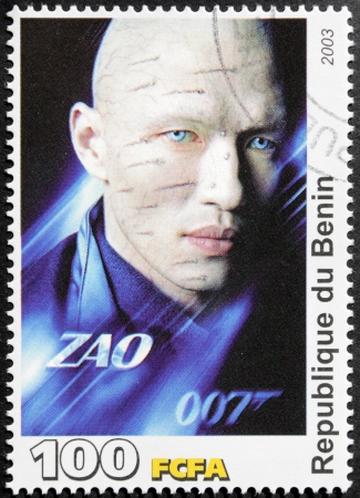 benin: BENIN - CIRCA 2003  A postage stamp printed by Benin shows American actor, screenwriter and producer Rick Yune starring in the film