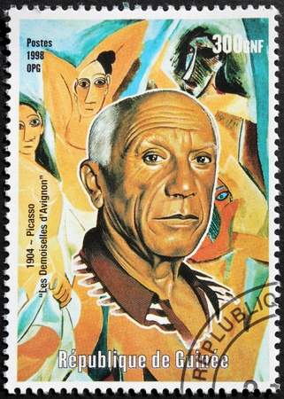sculptor: GUINEA - CIRCA 1998  A postage stamp printed by GUINEA shows image portrait of Spanish painter and sculptor Pablo Picasso who spent most of his life in France, circa 1998