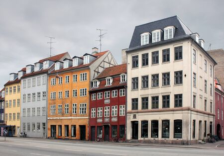 A view of the old colorful Copenhagen houses on the Christianshavn island in a cloudy day  photo