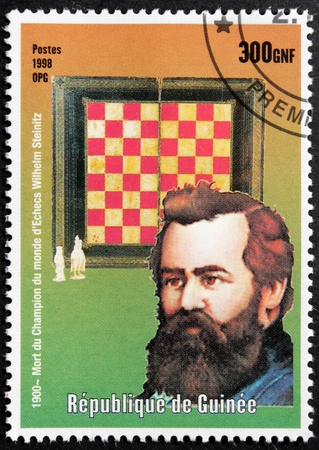 GUINEA - CIRCA 1998. A postage stamp printed by GUINEA shows image portrait of famous Austrian and then American chess player, first world chess champion Wilhelm (William) Steinitz, circa 1998. Stock Photo - 15625336