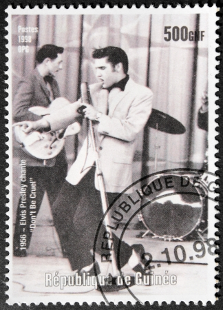 GUINEA - CIRCA 1998. A postage stamp printed by GUINEA shows image portrait of famous American singer Elvis Presley (1935-1977), circa 1998. Stock Photo - 15625335